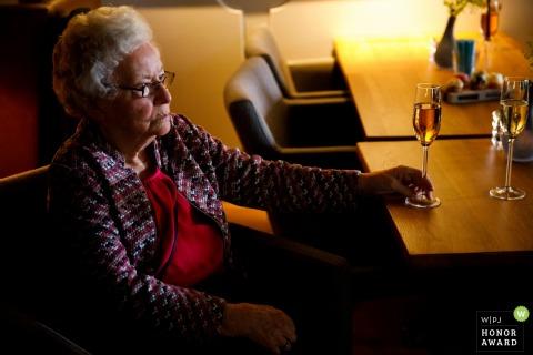 Hellendoorn- De Uitkijk - A contemplating grandma at the wedding reception
