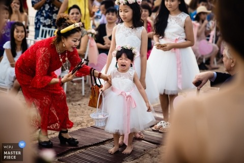 Phu Quoc Ho Coc Outdoor Wedding Ceremony photo of young flower girl crying.