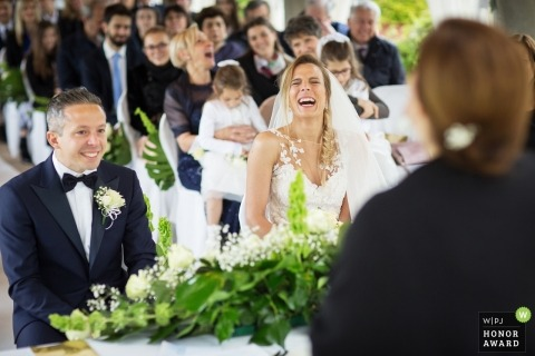 A bride laughs during her ceremony at the villa Necchi - Gambolò