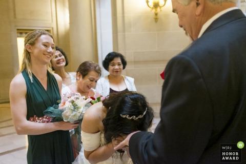 A very happy bride at the San Francisco City Hall.