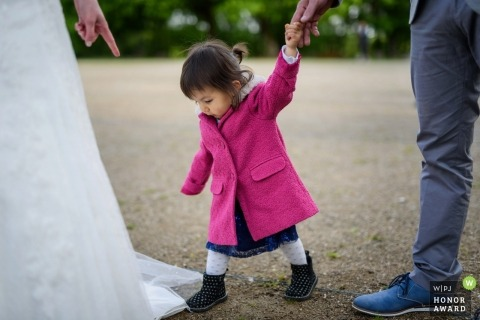 Little girl walking on the bride wedding dress in Auxerre