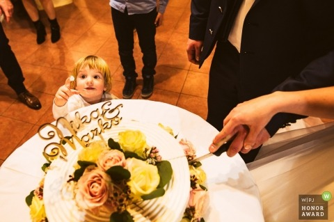 Curzon Hall, Sydney | Girl trying the cake before the first cut