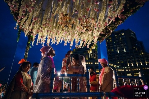 Fairmont, Ajman Wedding Ceremony Photographer Quote: During the exchange of garlands in an Indian wedding. When you miss the sunset but get the gorgeous blue skies!