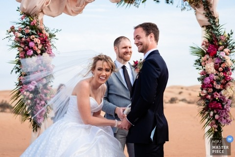 Al Maha Desert Resort Dubai Outdoor Ceremony in the Sand - Photo of the Brides reaction to the grooms joke