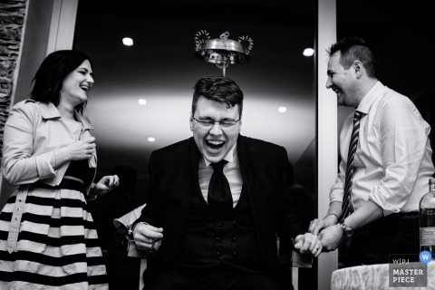Black and white photo of of guests playing games during the reception in Lago d'Iseo, Italy by a Budapest, Hungary wedding photographer.