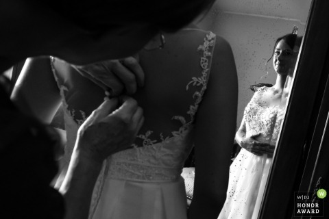 Lacing of the wedding dress before the ceremony in Verona, Italy