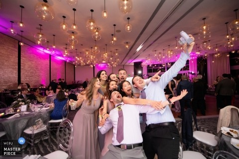 Epic Hotel, Miami, FL wedding photography - Cheese!!! big selfie during the reception party