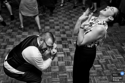 Granlibakken, Tahoe City, CA Wedding Photographer - Image of the groom and his sister getting down on the dance floor.