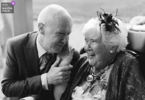 Dublin wedding photographer captured this black and white photo of a tender moment with grandma at a ceremony taking place at Clonabreany House