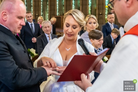 St. Joseph Kirche, Baden-Baden wedding photo - Emotional son in background while listening his mother