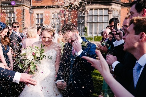 Capesthorne Hall, Cheshire, UK post-ceremony confetti in the face shot