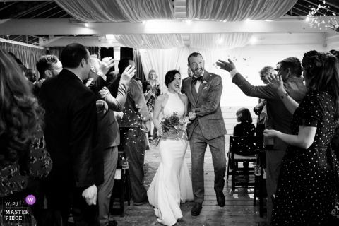 The East Quay Venue - Wedding photo of the bride and groom during their Recessional