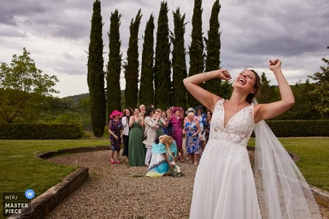 Villa La Selva Tuscany Wedding Photo During the Throwing of the Bouquet