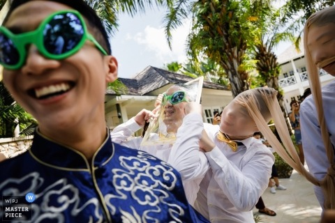 Bali Indonesia Wedding Photo of The Groom in the Game Outside with Groomsmen
