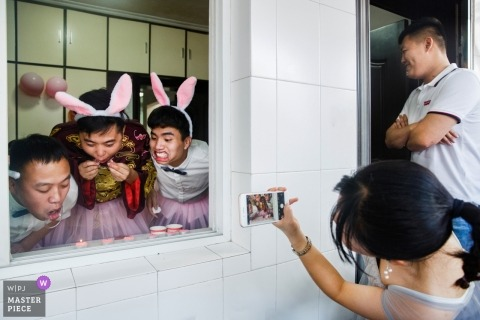 Fujian, China Wedding Photojournalism Image of Groomsmen Door Games