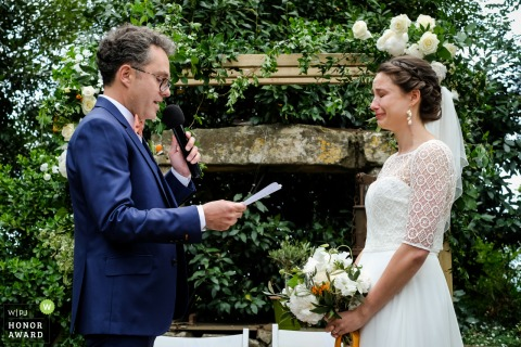 Outdoor wedding ceremony photo from Fon de Rey, Pomerols, France of Strong emotion