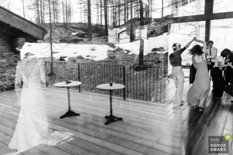 Les Neiges d'Antan - Cervinia - (Italy) wedding venue photography of the bride reflected in dancing action.