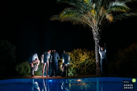Villa Mbastita wedding venue photography at the pool with the Groom and friends