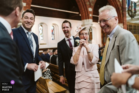 England Wedding Photography at St Andrew's Church of the guest arrival
