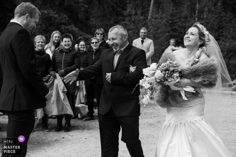 Pyramid Lake Resort, AB, Canada Wedding ceremony photography - image of the father giving away his beloved daughter.