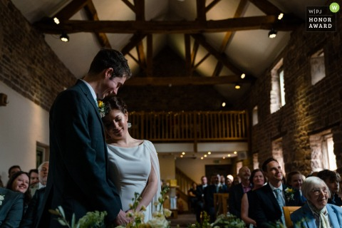 The Ashes Barn Staffordshire wedding venue photography | Bride and groom sharing a moment during their service at The Ashes