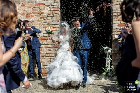 Oratorio della Santa Croce - Padua wedding photo of the typical Rice launch full of energy