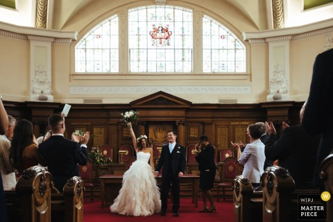Islington Town Hall Wedding Pictures - The jubilant bride at the end of ceremony