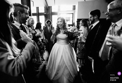 Harrild and Sons, London wedding photograph showing the bride arriving at reception