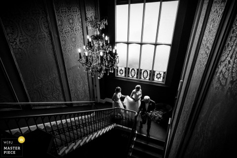 Nonsuch Mansion Wedding Photographer | Image of the bride walking to the ceremony down the stairs