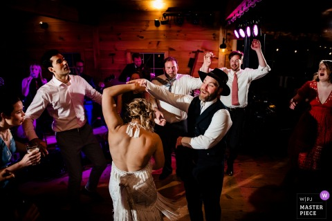 Tourterelle Wedding Photographer in New Haven, Vermont | The groom spins his bride during late night dancing at their reception.
