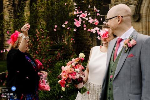 St James Church, Horsforth, Leeds wedding photo of the bride getting flower petal Confetti Eye