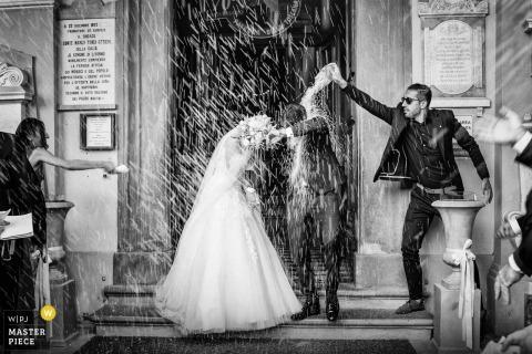 santuario di montenero livorno | wedding photography of the confetti moment with bride and groom