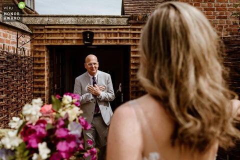 Seckford Hall, Suffolk wedding day photography = Father seeing his daughter just before the ceremony