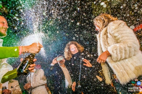 Dance floor champagne pop captured by White Wolf Lake Tahoe wedding photographer.