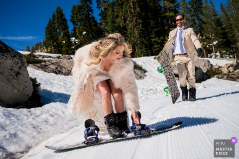 White Wolf Lake Tahoe Wedding Photography | Bride and groom strap in to ride down the mountain snow straight into their ceremony