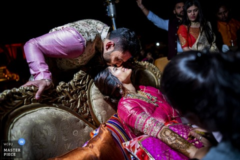 ahmedabad bride preparations, the greeting of the groom captured in this India wedding photograph