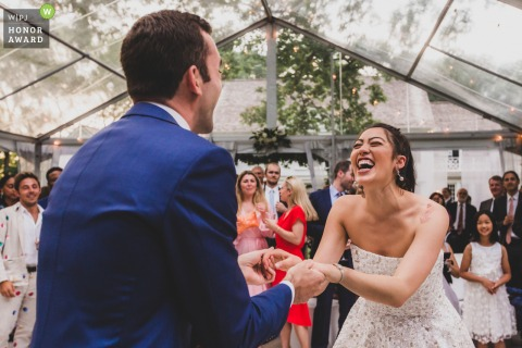 Backyard wedding photography in Weston CT - Bride and Groom on dance floor