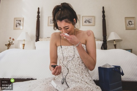 Bride's Home in Weston CT | Wedding Photography | Bride listening to her 'gift' from groom - a song he wrote, played and recorded for her