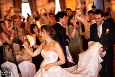 Castello di Susans - Wedding photography showing the entrance of the bride and the groom at the dinner