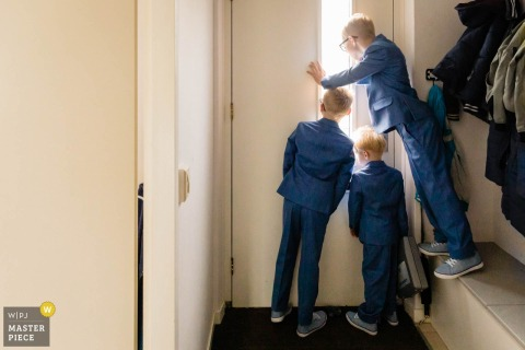 Netherland - Rotterdam - Lake 7 Wedding Photographer | Image of Sons waiting on father (the groom) to arrive