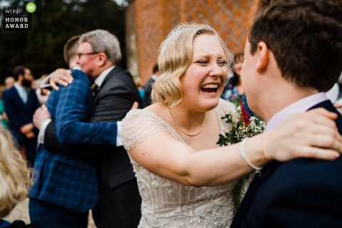 Farnham Castle, Farnham, Surrey, England wedding photography of Joyous hugs with your favourite people