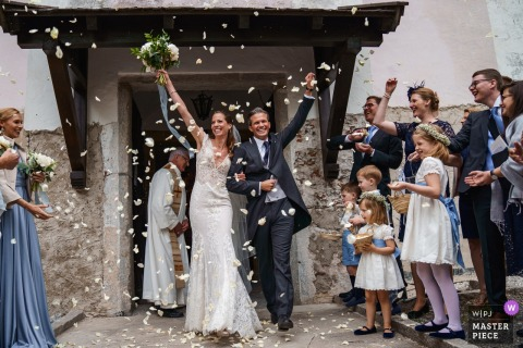 Zell Am See, Schloss Prielau, Austria wedding photo showing confetti exit for the happy bride and groom
