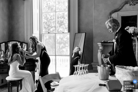 Black and White Wedding Photography at Glen Foerd - The Bride and her MOH putting on the final touches while her father is ready to get the party going.