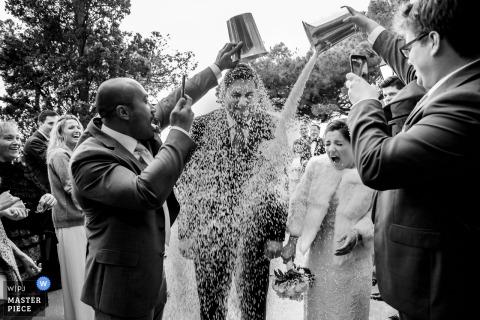 El Convento de Blanes - Wedding Photo of Rice throwing on Bride and Groom after their Ceremony