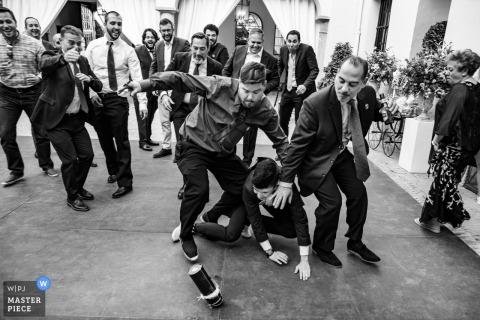 Wedding Photography at Palacio de Aldovea - Bridal garter throwing with gift box