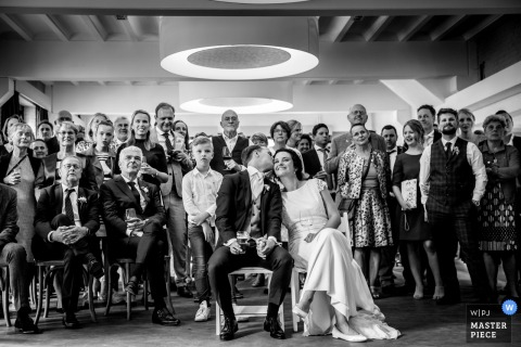 Wedding Reception Photography at Hengelo - De Houtmaat - image of slideshow watching with friends and family