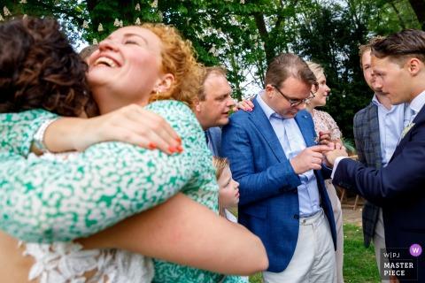 Hengelo - De Houtmaat Wedding Photography of Hugs and admiring of the wedding ring