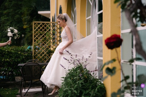 Villa Aura del Lago, Lake Como Bride leaves the house on wedding day in this photograph.