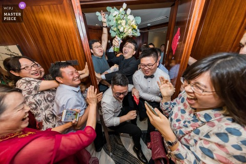 Guests and groomsmen are surprised in this documentary-style wedding photo by an award-winning Beijing, China photographer.