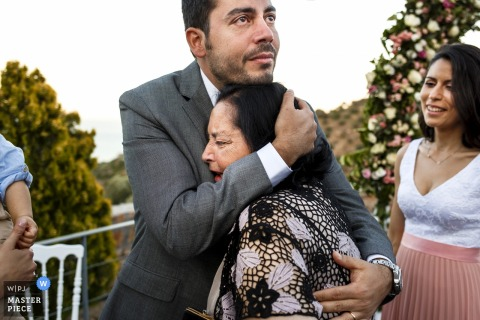 crete, greece - apxontiko kthma exculusive events - photo of emotional moment between groom and mom